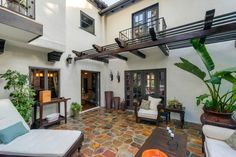 I like the flooring! Mediterranean Patio with exterior stone floors, Santa Barbara 2.75 Sq. ft. Natural Slate Meshed Flagstone Paver Tile, Trellis