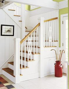 he staircase in the original home is narrow. When it came time to install a new one, the family made sure the design was open and the proportions welcoming.
