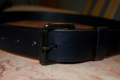 Classic leather brown belt. Made by Zartman Gear. Love the black on black!
