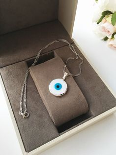 A personal favourite from my Etsy shop https://www.etsy.com/listing/489888285/white-evil-eye-choker-necklace-choker