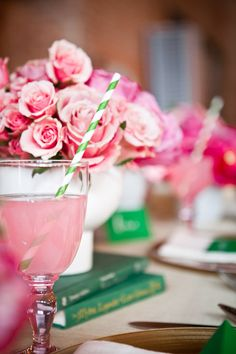 Pink and Green tablescape is lively for a shower... also like the use of books to add variation of height.