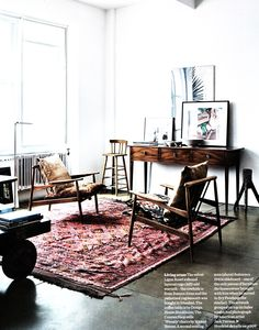 """elle decor uk. the rug reminds me of my """" soul rug""""..the one I fell in love with the second it was plopped down in front of me in a dusty converted palace. and the frames propped up like that are simple and perfect.This is both a woman and a mans room"""