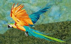 silver linings quilting pattern blue and yellow macaw.  Adapt head and to reds for Fawkes?