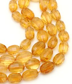 Citrine Fac Oval 9x7-11x8mm.  These faceted ovals have a rich, medium amber hue.