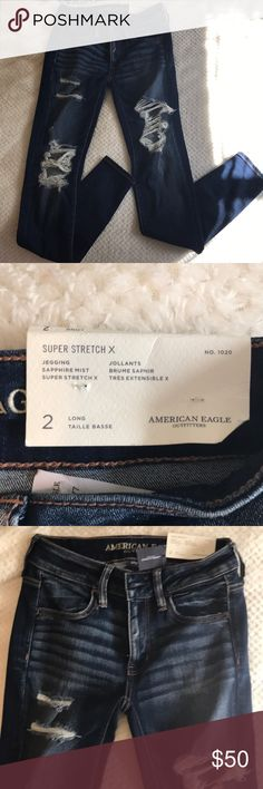 American Eagle Ripped New Jeans American Eagle Ripped dark blue size 2 Long Jeans. Super Stretch X, jeggings, low rise, and awesome!!! My favorite jeans! First photo isn't the exact ones (different rips in that one) but shows the low rise jegging fit... American Eagle Outfitters Jeans