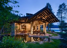 Who else (besides me) wants this huge covered porch with the amazing natural pond right up against the patio?  Just gorgeous!