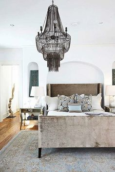 Tracery Interiors - Chic blue/brown bedroom with Arteriors Maxim Chandelier, mink brown ...