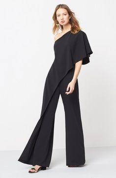 One-Shoulder Jumpsuit Beautifully draped fabric ends in a cascade of ruffles down the shoulder of this stunning one-piece with voluminous palazzo pants that further the drama. Look Fashion, Fashion Outfits, Fashion Design, One Shoulder Jumpsuit, Wedding Jumpsuit, Ruffle Jumpsuit, Pants For Women, Clothes For Women, Mademoiselle