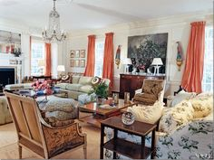 Tory Burch's living room.... an example of that punch of apricot I was thinking.  Here it's called pink grapefruit.