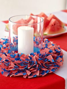 About 300 miniature flags make up this eye-catching centerpiece. It's easier to make than you might think. #redwhiteandblue #4thofjuly #4thofjulyparty #partyideas #4thofjulydecorations #bhg 4th Of July Cake, Fourth Of July Decor, 4th Of July Celebration, 4th Of July Decorations, 4th Of July Party, July 4th, Easy Decorations, Patriotic Party, Party Hacks