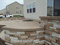 Stamped patio with stone sitting walls in Lake St. Louis, Missouri