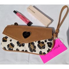 BETSEY JOHNSON CHEETAH WRISTLET CLUTCH NWT. BETSEY Johnson envelope cheetah wristlet. No flaws rips or stains. Super cute! Faux leather with gold hardware. Zip top closure and outside envelope pouch. Magnetic snap closure. Measures approx 8x4 inches. No trades no PayPal. Please ask all questions and view photos before purchase. Thank you !! Betsey Johnson Bags Wallets