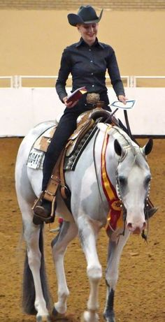love how simple her outfit is, goes to show that its on the rider not the tack. winning