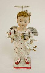 I love this artist --Debbie Thibault -- she makes darling old fashioned, miniature,  paper mache type dolls.