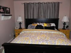 Yellow & gray -- I will be using a similar color scheme in our guest room (not the black bed); maybe an upholstered headboard and lighter colored pillows.  Do love the bedding though.