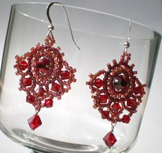 Handmade earrings with Swarovski crystals and sterling silver.