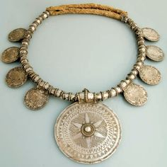 Africa | Necklace from Zanzibar, Tanzania | silver | This necklace would have been imported from Oman, by the Omani sultans who had magnificent palaces in Zanzibar.  This splendid jewellery is worn by local women today, such as this one composed of a central medallion and 8 Marie Theresa Thalers.