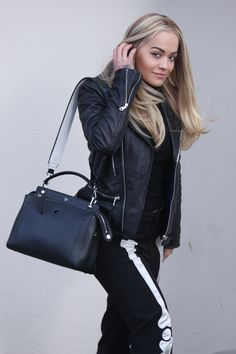 Rita Ora spotted in London with the new Fendi Dotcom bag matched with a double-faced Strap You.