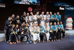 (L-R) Silver medal winners Spain, Gold medal winners Russia and Bronze medal winners Ukraine celebrate on the podium after the Synchronized Swimming Team Free Final on day seven of the 15th FINA World Championships at Palau Sant Jordi on July 26, 2013 in Barcelona, Spain.