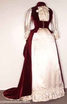 """A flattering original circa 1887 lady's two piece afternoon reception gown with a wine silk velvet polonaise with waterfall bustle and a full train."""