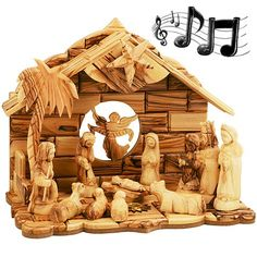 """12 Piece large Musical Nativity Set - All lovingly hand carved from olive wood in Bethlehem featuring individually carved pieces and olive wood floor and wall created from blocks.  By turning the Star on the Nativity set """"Silent Night"""" is played!  The floor of the Manger features a Bethlehem Star with window and Incense from Jerusalem inside."""