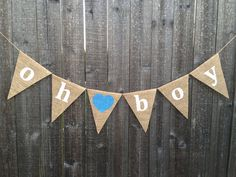 Oh Boy burlap banner. Painted in white with a light blue heart in the middle. Adorable to use at baby shower, baby/gender announcement, and/or