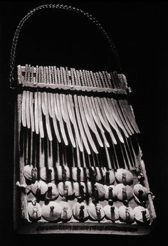 The nyonganyonga is a lamellaphone, an instrument consisting of thin metal or split cane tongues mounted on a resonating board or box.
