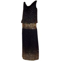 Michael Maiello for Pat Richards black evening gown lavishly embellished with tiny gold sequins | United States, 1980's | Dress has scoop neck, dropped waistline and is fitted around the hips. The tiny gold sequins are concentrated around the hip line creating a thick band. The skirt falls straight from the hips and the sequins are interspersed sparingly and then concentrated at the hem line
