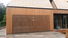 """""""Original sectional garage door design with vertical timber louvres to match facade. Glazed sectional panels adapted to be clad with timber on site. Timber Garage Door, Garage Door Panels, Diy Garage Door, Modern Garage Doors, Carport Garage, Garage Door Design, Garage House, Sectional Garage Doors, Wood"""