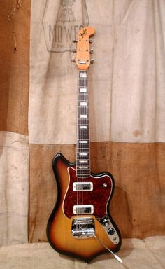 Fender Custom Maverick 1969 Sunburst | Modified to utilize a pair of early 70's Gibson mini-humbuckers.