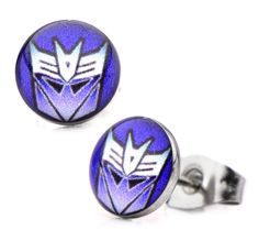 Transformers Logo Stud Earrings Decepticon Round Print Purple Blue Stainless Steel. Officially licensed product. Comes in licensed packaging. Stainless steel.