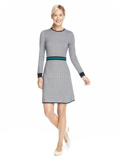 This structured sweater dress boasts a flattering fit-and-flare silhouette and a contrast stripe belt. It's pretty much one of our favorite fall pieces (and we think you'll love it too).