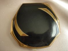 I LOVE this one! Black Enamel & Brass Compact