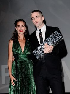 actress Berenice Bejo presenting Robert Pattinson an award at Deauville film festival US, September 2, 2017