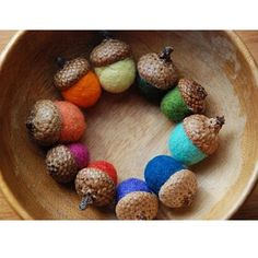 Rainbow colored felted acorns.