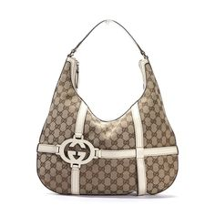 Authentic Gucci hobo bag. Done in the traditional Gucci monogram canvas this bad features ivory leather trim and detailing. The detailing forms a grid pattern across the bag with the interlocking Gs to one side. With gold toned hardware - goalsBox™
