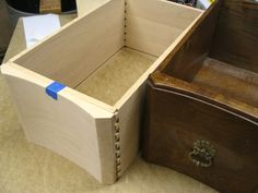 """An Antique Replacement. The sides were red oak milled to 7/16"""" thickness.  The drawer sides are dovetailed.  The front has a sculpted profile and is made of beech to match the original design.  Here the drawer is being dry fitted before the top and bottom details are applied to the drawer front."""