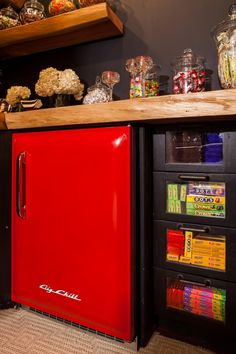 Match made in heaven. Take a look at this drool worthy Candy Dispenser and Cherry Red Big Chill Fridge. Available: bigchill.com/