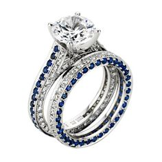 Blue sapphires and diamonds line the band of this semimount engagement ring and matching wedding band.