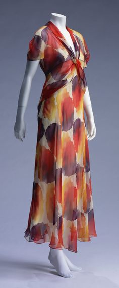 "Dress, Madeleine Vionnet: ca. 1933, bias-cut silk chiffon with long sash twisted and wrapped around dress. ""Using soft chiffon cut on the bias, the lines of the body are enlivened. Moreover, as the cloth at the chest is twisted, the garment gives of a full three-dimensional feeling. This dress' decorative techniques are characteristic of Madeleine Vionnet at that time. Vionnet's creativity and haute couture handwork is splendidly united in this garment..."""