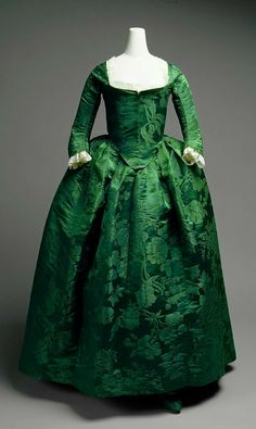 """Gown: ca. 1775, American, silk damask, shown with neck lace and engageantes. A transition between Robe à l'anglaise (notice the """"petticoat"""" and skirt are one piece, not two) and the """"Round..."""