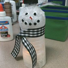 Cut out bottom of water bottle, paste white tissue paper for snowman body, paste black tissue paper on water cap, roll small orange tissue paper square to make carrot nose, embellish with coal eyes and nose, add ribbon scarf. Place electric tea light underneath
