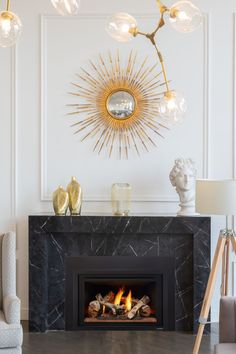 A glam, contemporary space deserves a modern fireplace upgrade with marble front. The glowing logs are a stunning replica of a real wood fire. The Heat & Glo Supreme gas insert fits directly inside your old fireplace, giving you warmth and comfort at the touch of a button. Talk about an easy renovation project! Indoor Gas Fireplace, Linear Fireplace, Old Fireplace, Fireplace Remodel, Fireplace Inserts, Modern Fireplace, Contemporary Fireplaces, Gas Insert, Wood Mantels