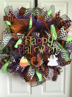 Happy Halloween deco mesh wreath. Curly technique, black, orange, purple and white deco mesh. Green, black and orange ribbons. Halloween, pumpkin. Ghost. Candy corn.   https://www.facebook.com/pages/GGs-Decos/450556885063473