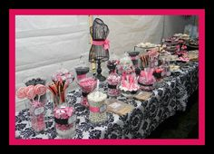 This was created with candy from www.candypros.com by Marina Vazquez for her daughter's baby shower. Love the pink black and white theme! Very cute, and the dress is a great touch! It's so fun to see what props can add to a candy buffet. Well done!
