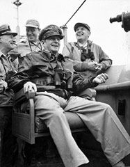General Douglas MacArthur watches bombardment of Inchon from the bridge of the USS Mount McKinley . He is flanked by (from left) Vice Admiral A.D. Struble, Major General E.K. Wright, and Major General Edward M. Almond, X Corps commander.