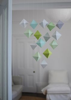 If you thought mobiles were just for kids' rooms, think again. This mobile of polyhedron paper shapes is a beautiful sculptural addition for any room of your home. Choose colours to suit your space...
