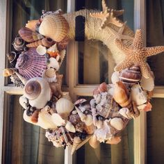 DIY summer wreath...I had a TON of sea shells...I will have to see if I can find them