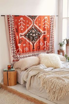 """Hanging a tapestry, quilt, or rug above your bed is a great way to add a little bit of style and a little bit of cozy texture to any bedroom. This rod for displaying tapestries is from <a href=""""http://www.urbanoutfitters.com/urban/catalog/productdetail.jsp?id=36889152&color=001#/!/"""">Urban Outfitters</a>, or if you're handy you could simply mount a curtain rod to the wall above your bed."""