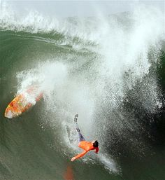 A surfer wipes out during a competition in Half Moon Bay, Calif